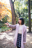 Young woman found something interesting in autumn forest