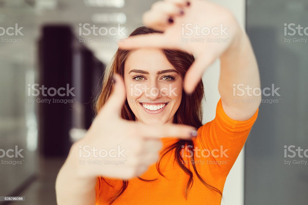 Young woman framing with hands stock photo