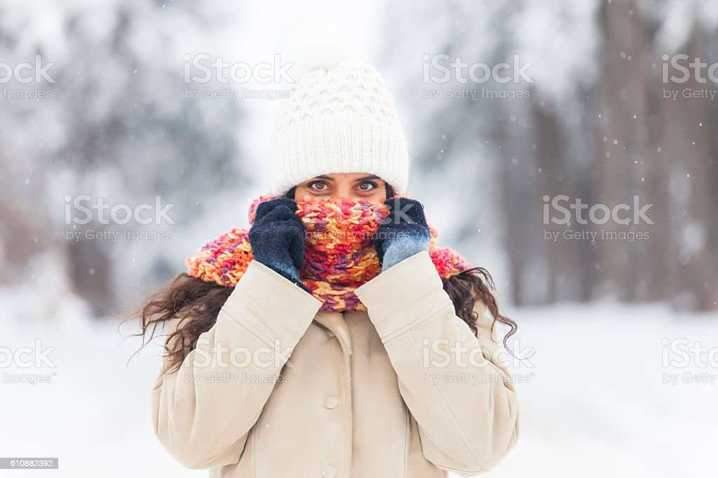Young woman freezing fun in the snow forest stock photo