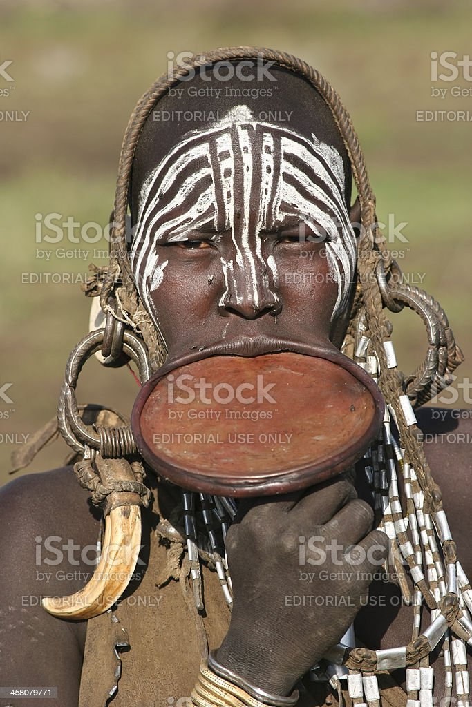 Young Woman From A Mursi Tribe royalty-free stock photo