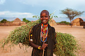 Young woman from Erbore tribe carrying grass, Ethiopia, Africa
