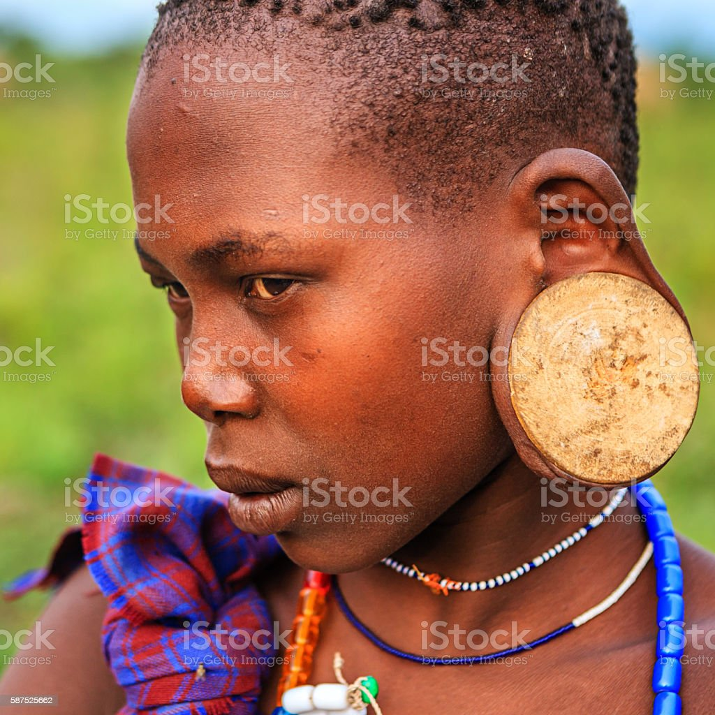 Young woman from Mursi tribe, Ethiopia, Africa stock photo