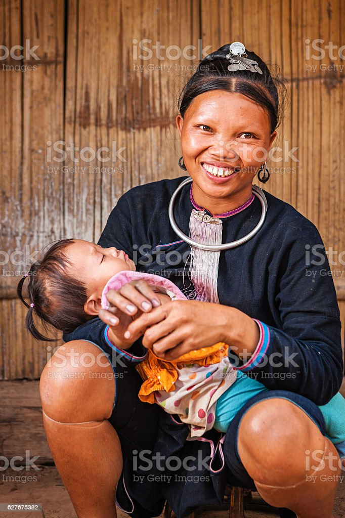 Young woman from the hill tribe holding her baby stock photo