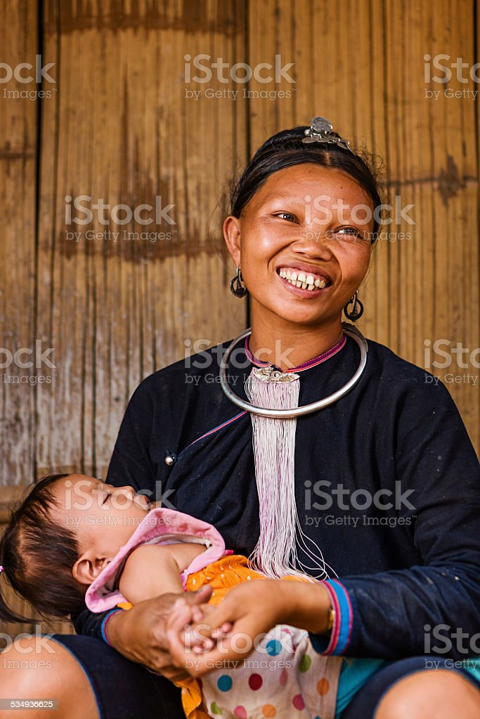 Young woman from the Lantan hill tribe breastfeeding her baby stock photo