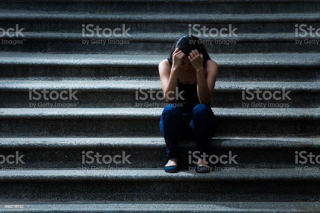 Young woman frustrated on the stairs stock photo