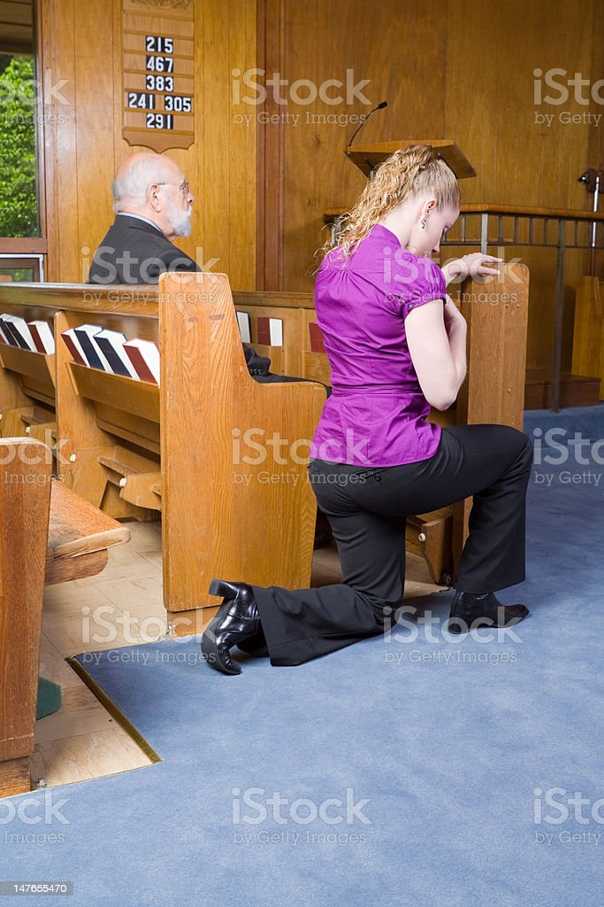 Young Woman Genuflecting Sign of the Cross Church Pew royalty-free stock photo