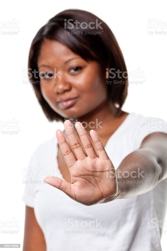 Young Woman Gestures Stop Hand Sign royalty-free stock photo