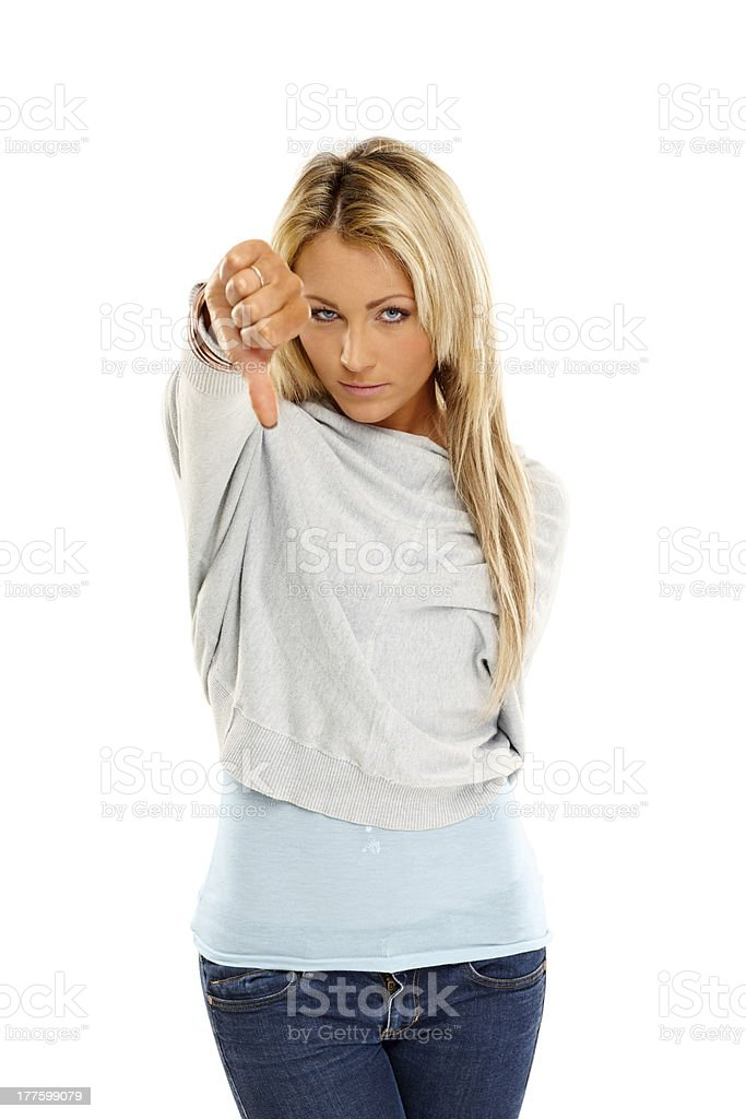 Young woman gesturing thumbs down royalty-free stock photo