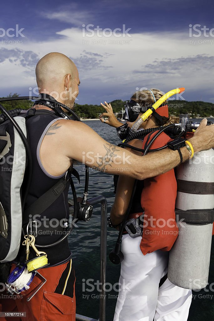Young Woman Gets Ready to Scuba Dive in the Ocean royalty-free stock photo
