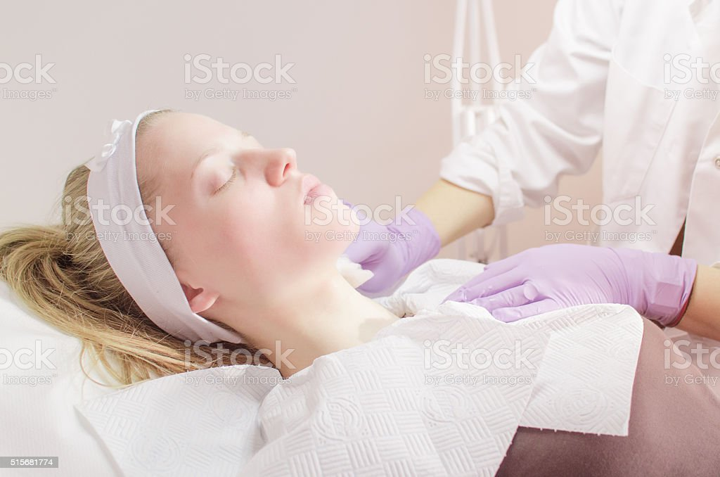 Young woman getting a facial treatment stock photo
