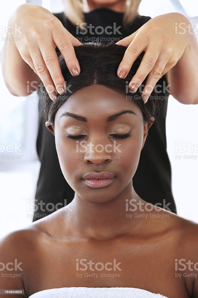 Young Woman Getting a Head Massage stock photo