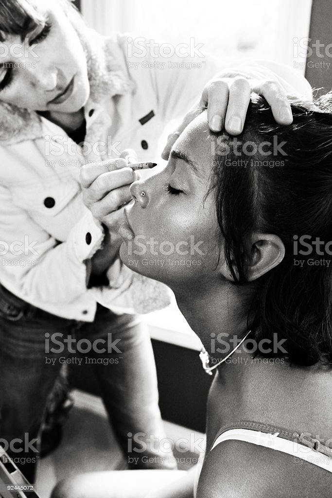 Young Woman Getting a Makeover royalty-free stock photo