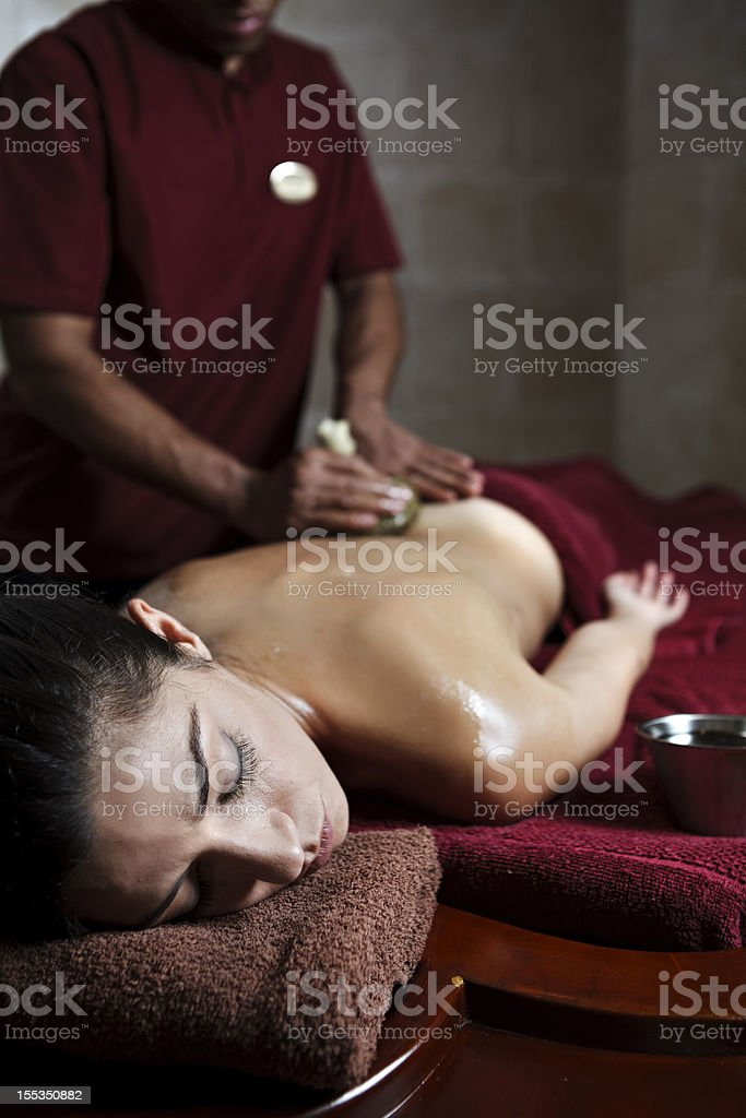 Young woman getting a navarakizhi massage royalty-free stock photo