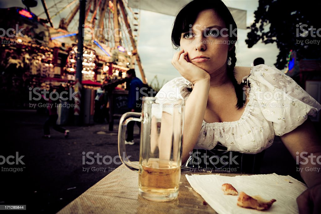 young woman getting bored at the carnival royalty-free stock photo