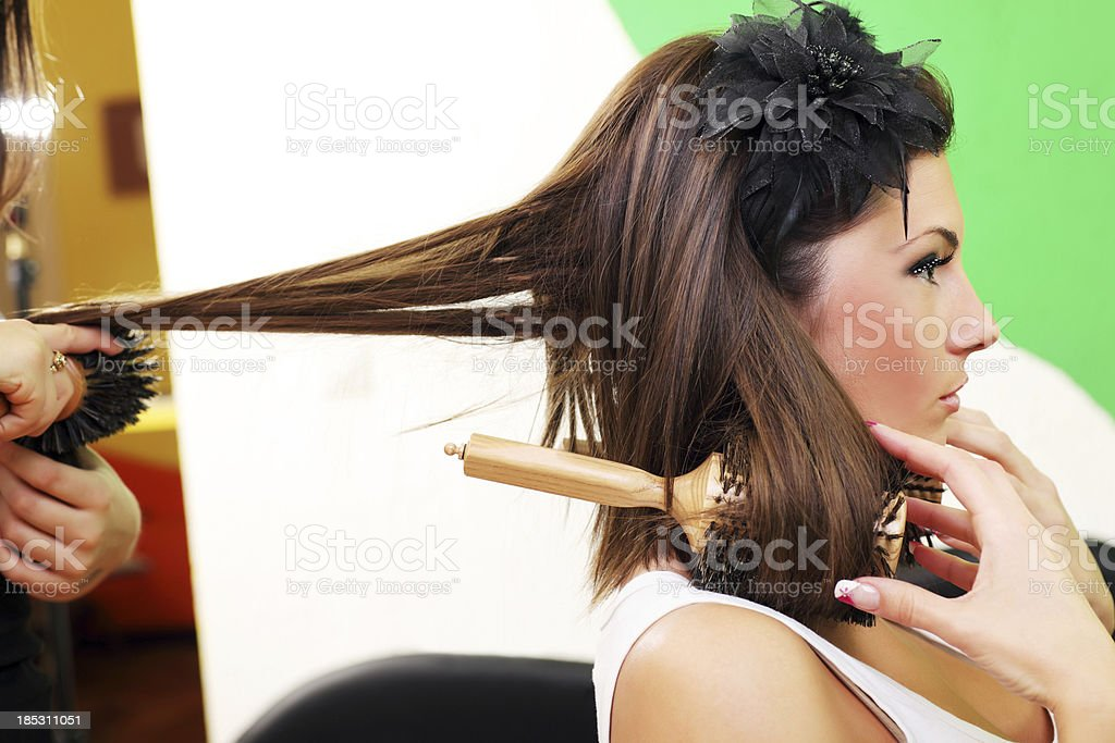 Young woman getting hair style at hairdresser. royalty-free stock photo
