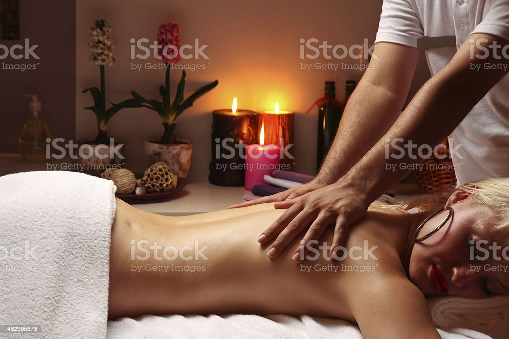 Young woman getting massage royalty-free stock photo