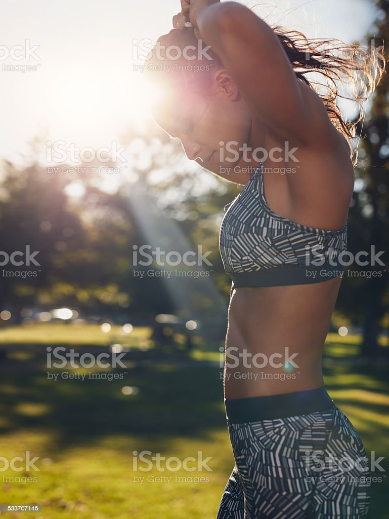 Young woman getting ready for exercising at the park stock photo