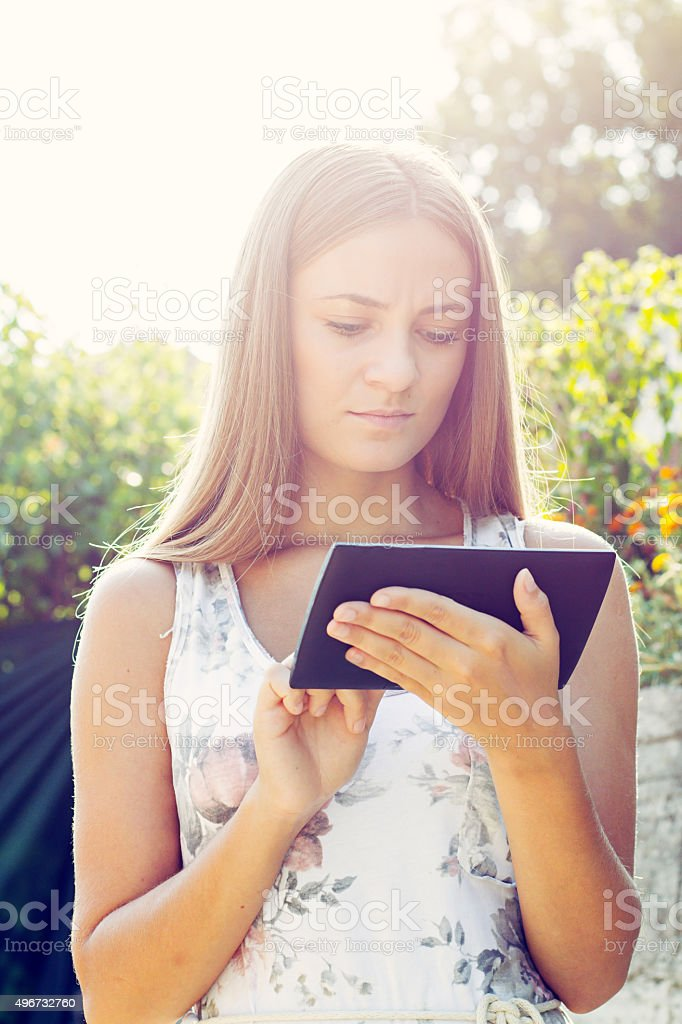 Young Woman, Girl Working With Tablet in Green Field, Park stock photo