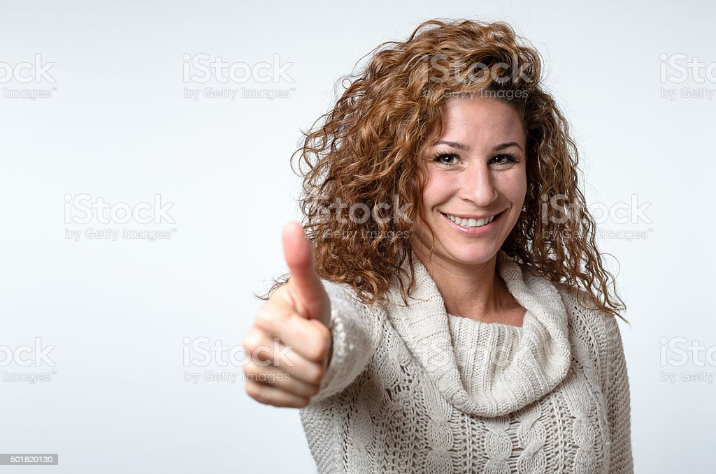 Young woman giving a thumb up gesture stock photo