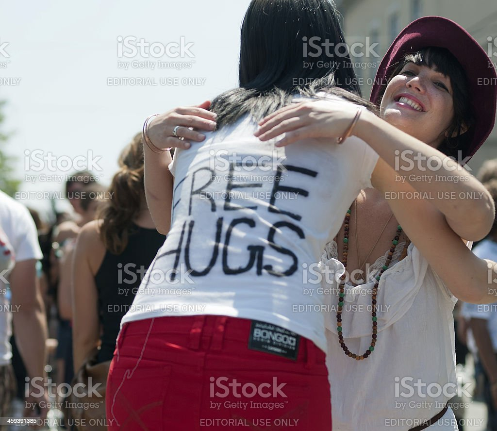 Young Woman Giving Away Free Hugs royalty-free stock photo