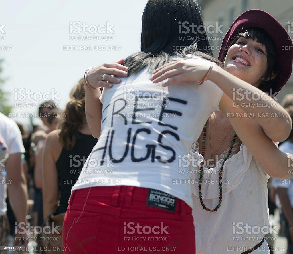 Young Woman Giving Away Free Hugs stock photo