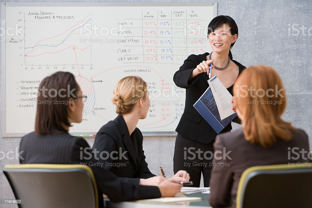 Young woman giving lecture stock photo