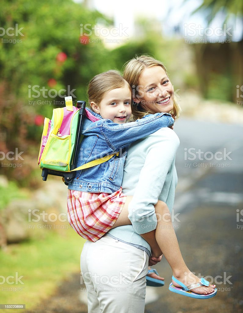 Young woman giving piggyback to her daughter royalty-free stock photo