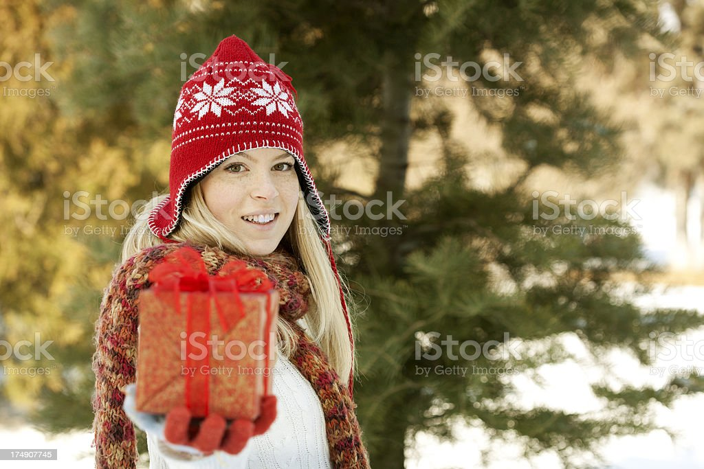young woman giving you present royalty-free stock photo