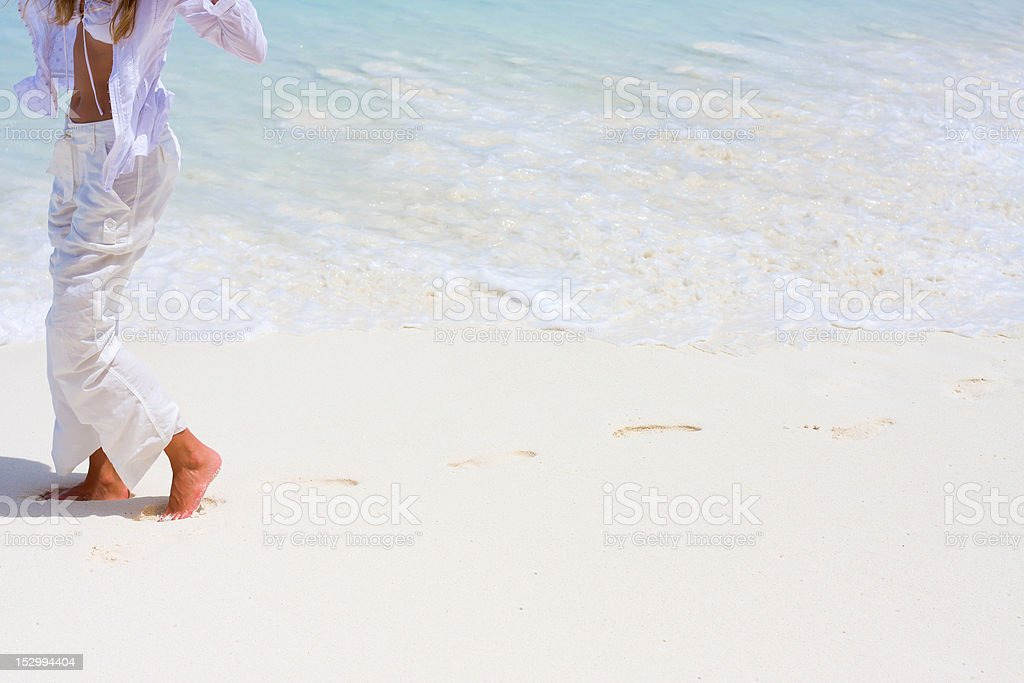 Young woman goes on a coastline royalty-free stock photo
