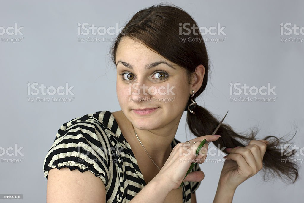 Young woman going to cut her long hair royalty-free stock photo