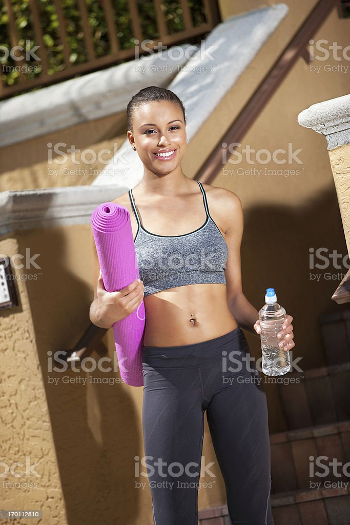 young woman going to yoga class royalty-free stock photo