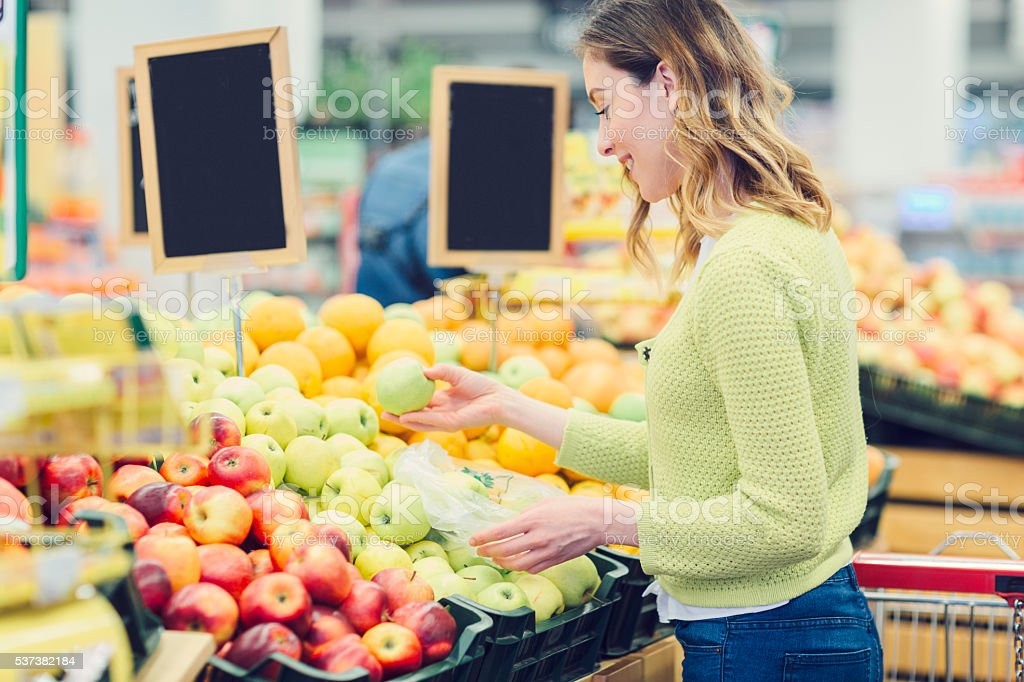 Young Woman Groceries Shopping. stock photo