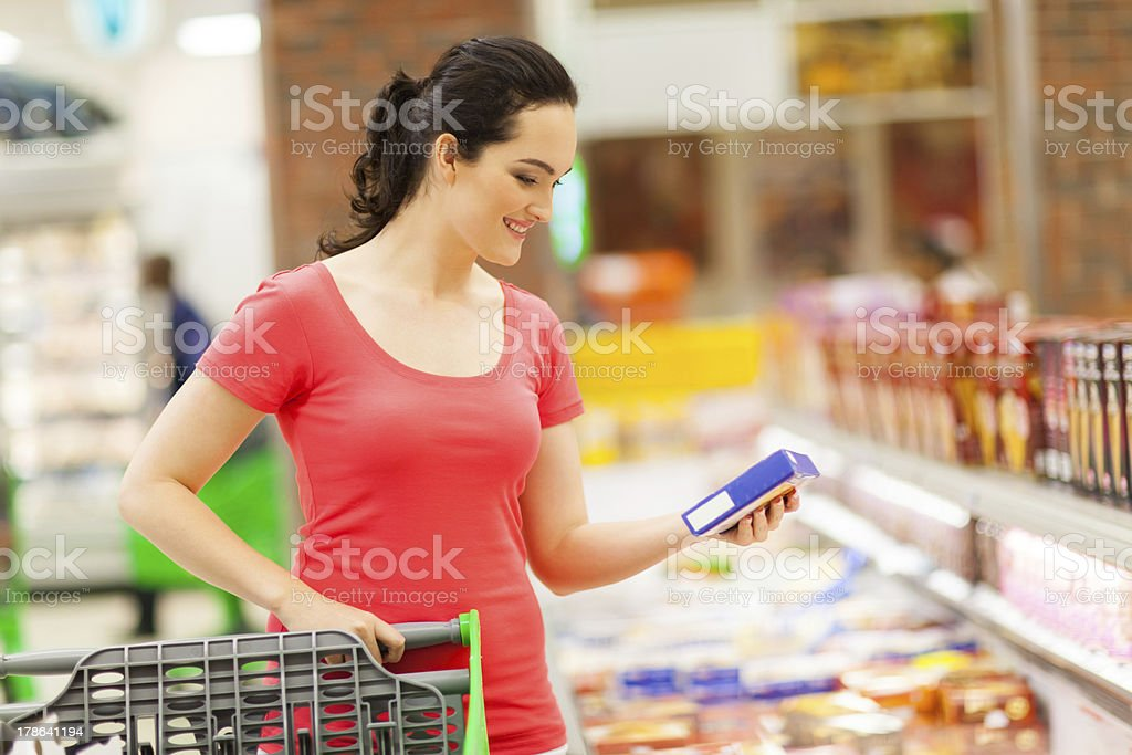 young woman grocery shopping stock photo