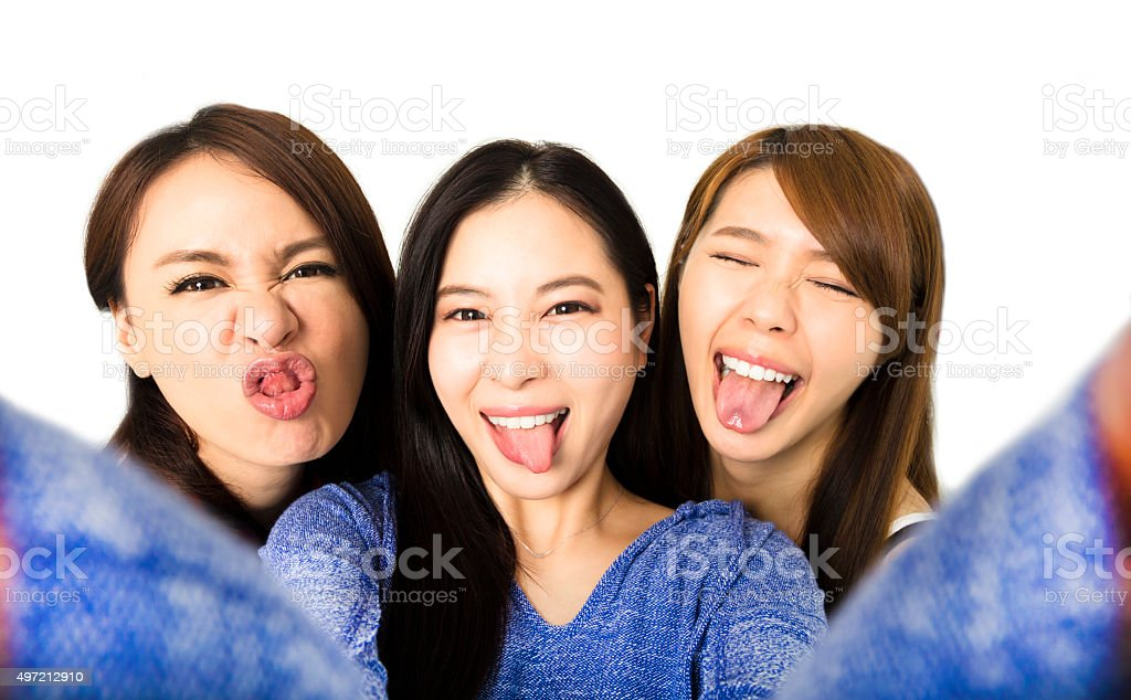 young woman group having fun together and taking selfie stock photo