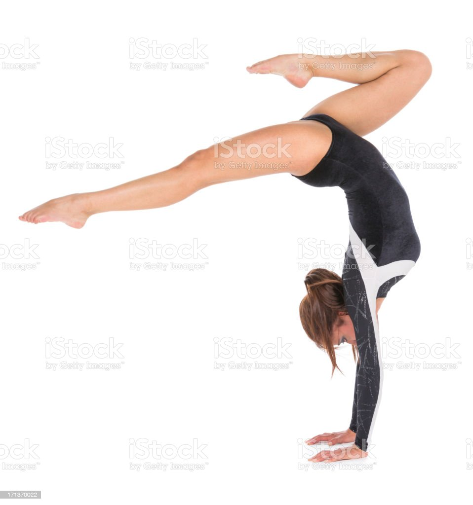 Young woman gymnast doing handstand stock photo