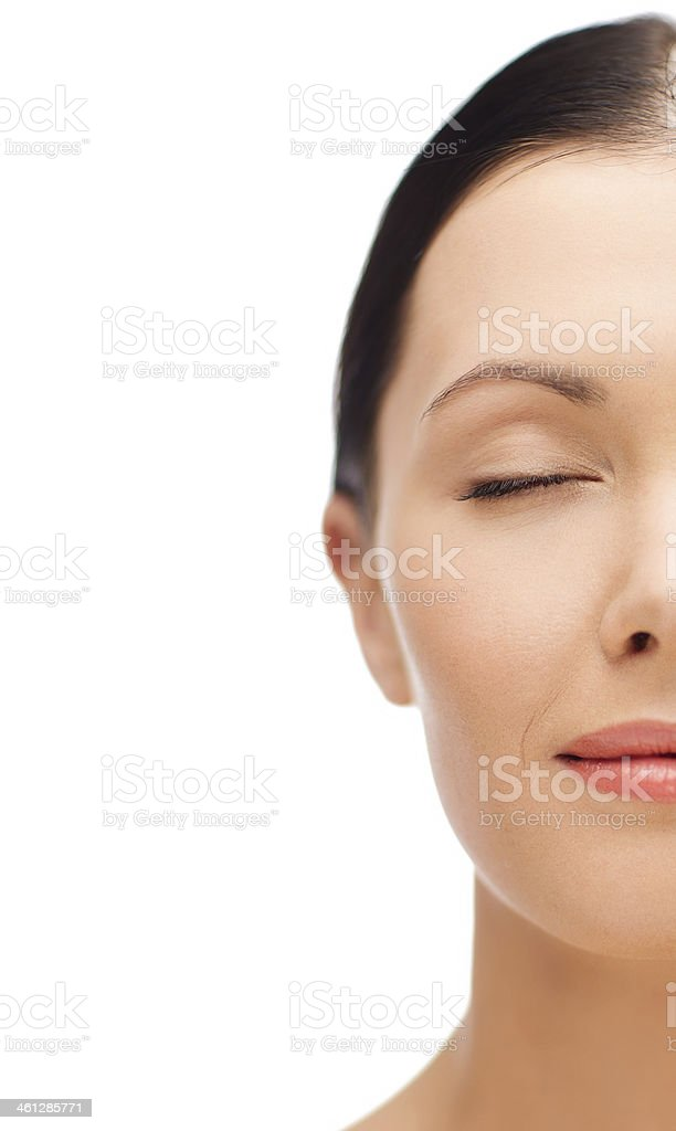 young woman half face with closed eyes stock photo