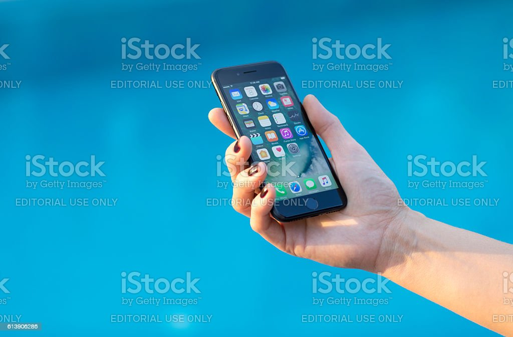 Young woman hand holding Apple iPhone 7 Black stock photo