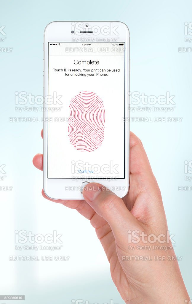 Young woman hand holding the Apple iPhone 6 stock photo