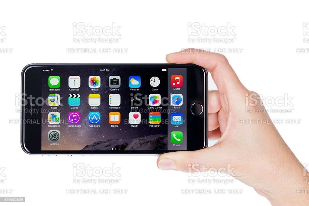 Young woman hand holding the Apple iPhone 6 Plus stock photo
