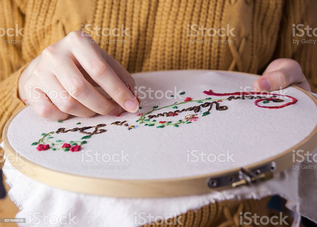 Young woman hands are embroidered happy valentines day stock photo