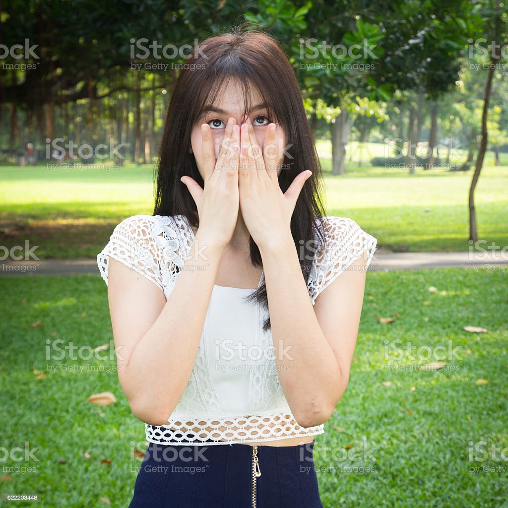 Young woman hands hand over mouth and nose stock photo