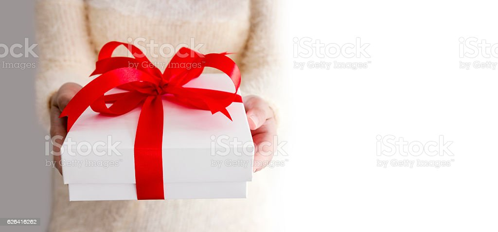 Young woman hands holding white gift box stock photo