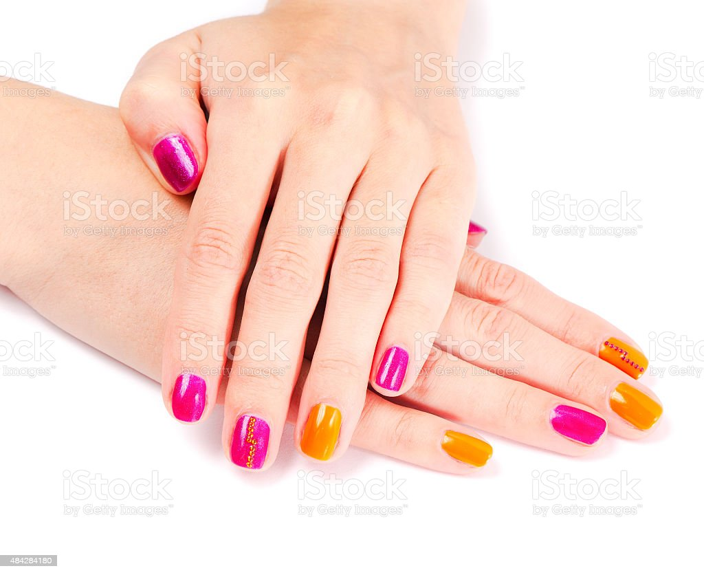 Young woman hands with colorful manicure stock photo