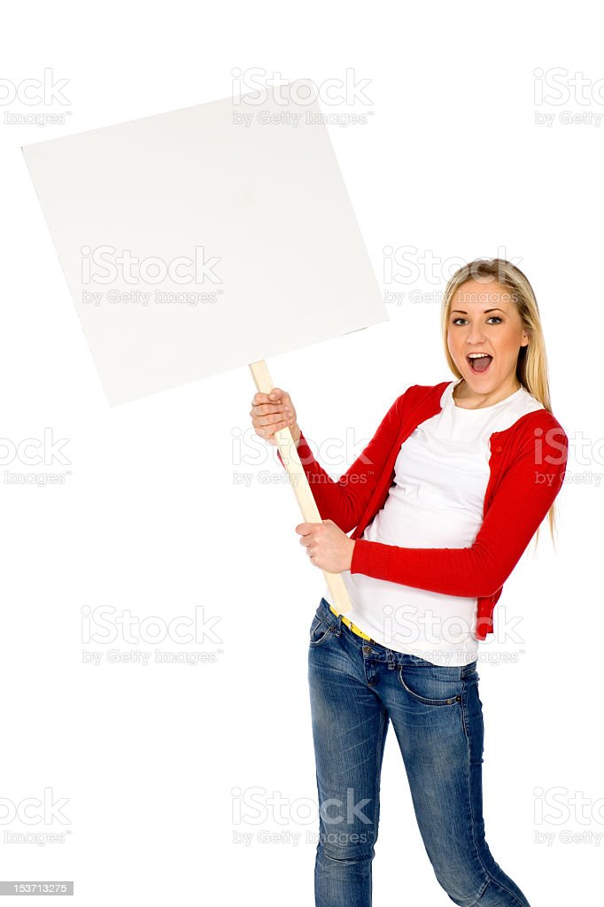 Young woman happily holding a blank poster royalty-free stock photo