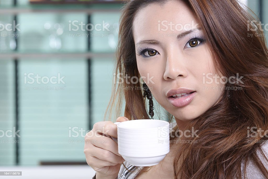 Young Woman Happy In Her Kitchen At Home royalty-free stock photo