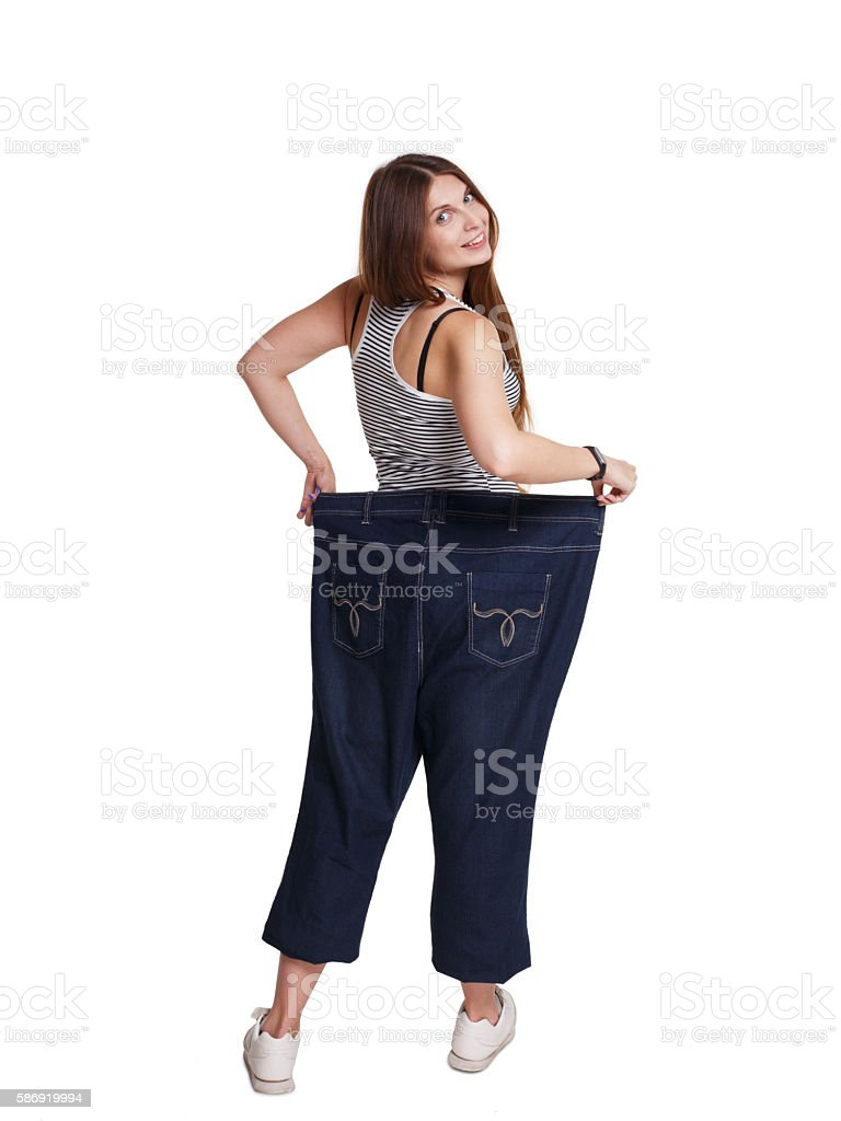 Young woman happy of weight loss diet results, isolated stock photo