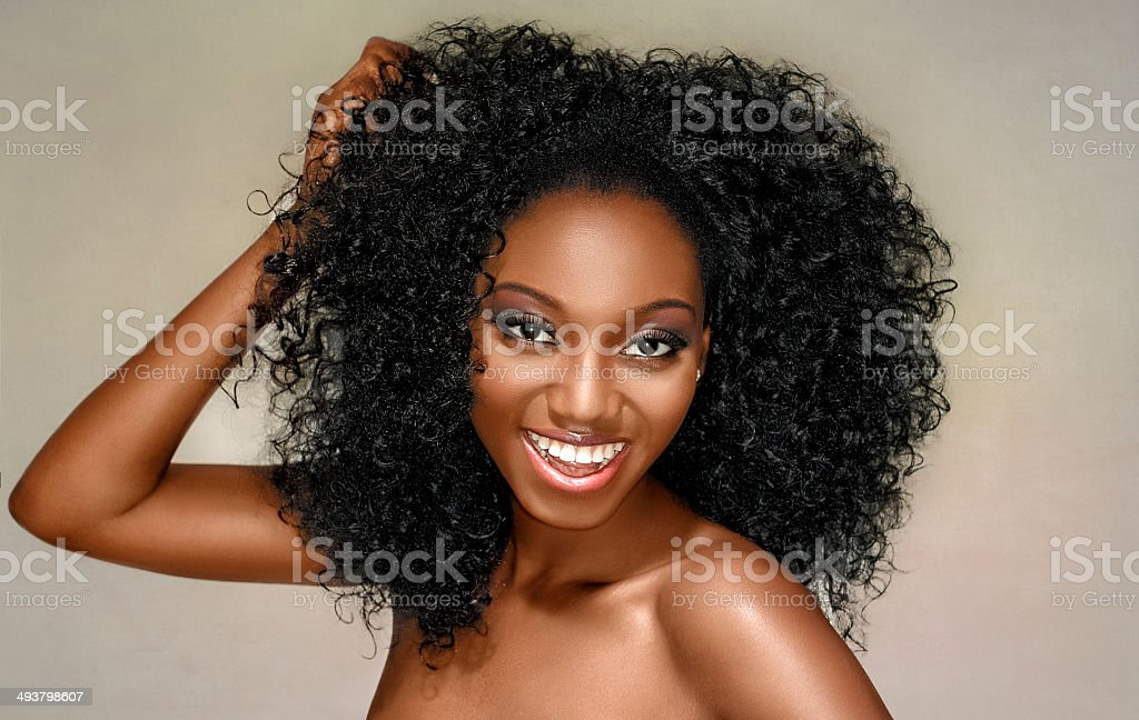 Young woman happy with curly hair on a white background stock photo