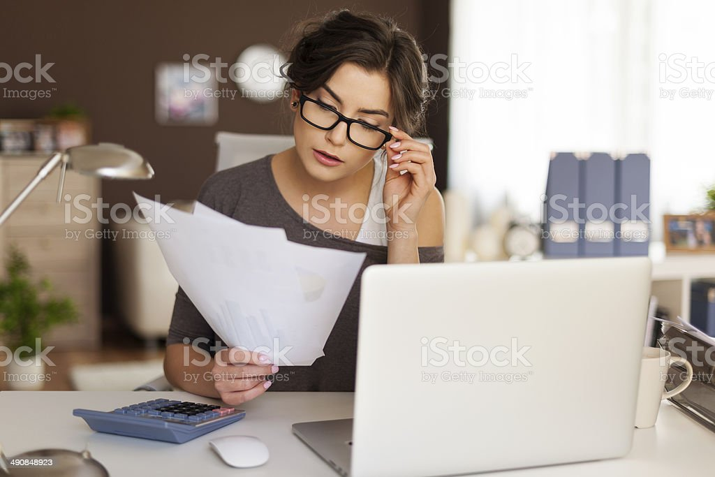 Young woman hard working at home stock photo
