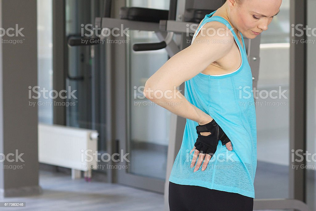 Young woman has a pain stock photo