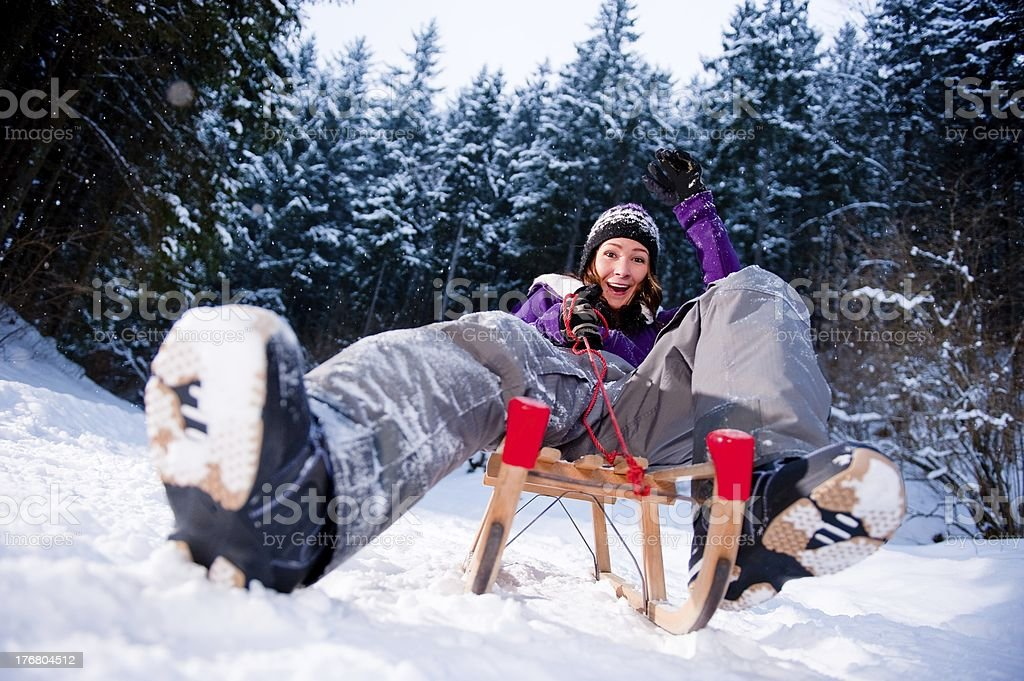 Young woman has fun with her sled stock photo